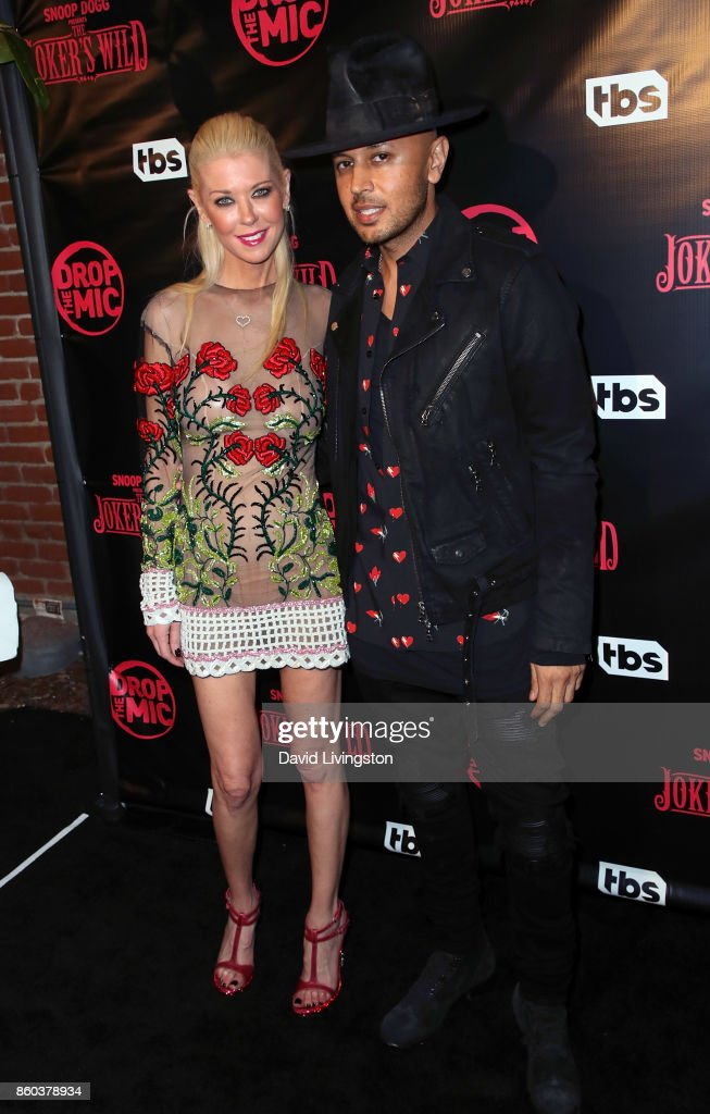 Actress Tara Reid (L) and cofounder and president of engage:BDR Ted Dhanik pose at the premiere for TBS's 'Drop The Mic' and 'The Joker's Wild' at The Highlight Room on October 11, 2017 in Los Angeles, California.
