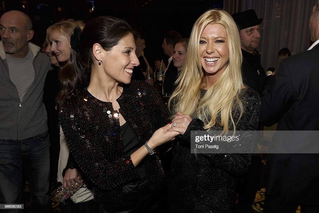 Actress Tara Reid and friend showing the ring attend the Movie Meets Media at Ritz Carlton Curtain Club on February 12 2010 in Berlin Germany