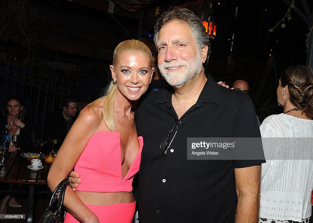 Actress Tara Reid and producer David Garber attend the premiere after party of The Asylum & Fathom Events' 'Sharknado 2: The Second One' at Figueroa Hotel on August 21, 2014 in Los Angeles, California.