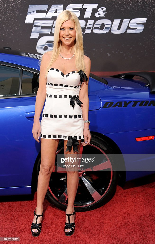 Actress Tara Reid arrives at the Los Angeles premiere of 'Fast & The Furious 6' at Gibson Amphitheatre on May 21, 2013 in Universal City, California.