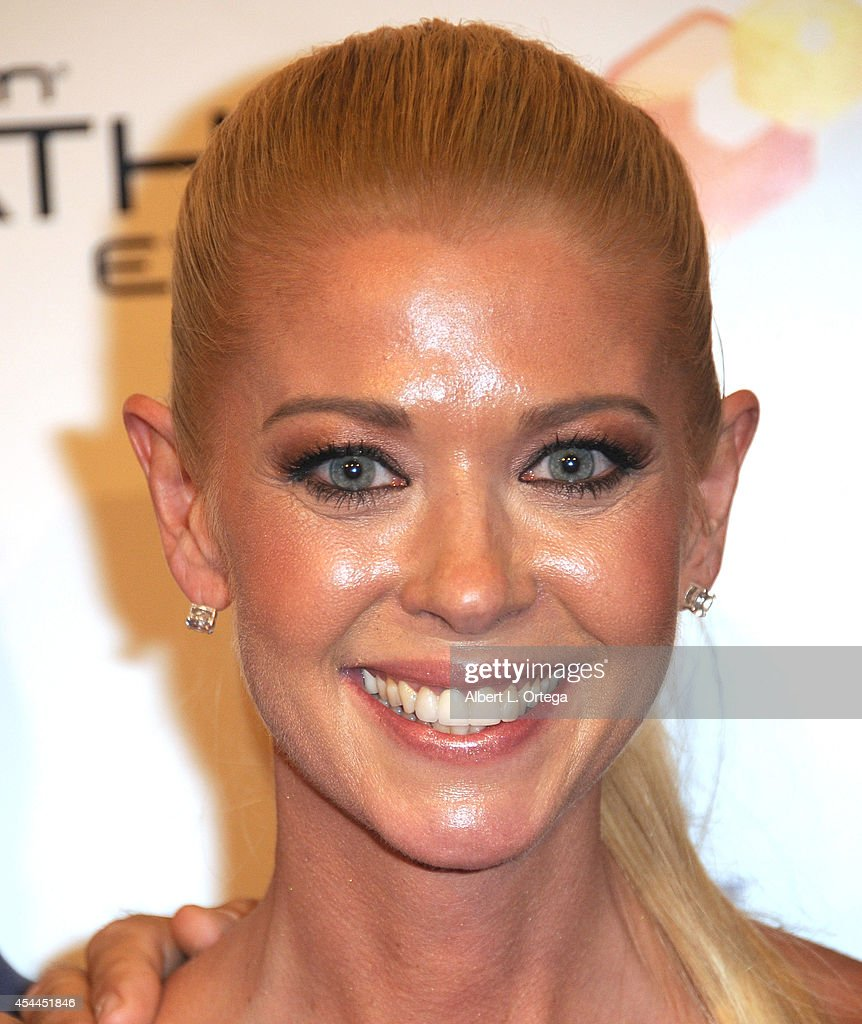 Actress <a gi-track='captionPersonalityLinkClicked' href=/galleries/search?phrase=Tara+Reid&family=editorial&specificpeople=202160 ng-click='$event.stopPropagation()'>Tara Reid</a> arrives for the Premiere Of The Asylum & Fathom Events' 'Sharknado 2: The Second One' held at Regal Cinemas L.A. Live on August 21, 2014 in Los Angeles, California.