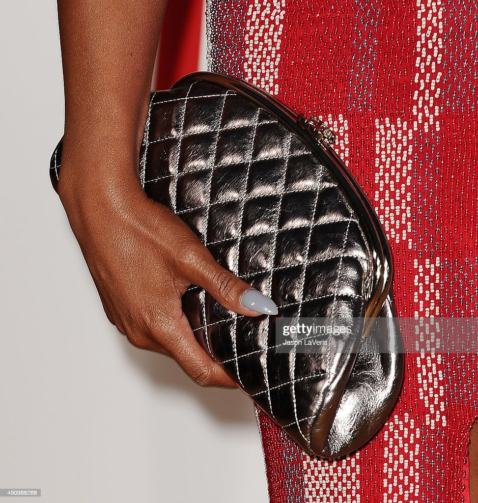 Actress Taraji P. Henson (handbag detail) attends the premiere of 'Think Like A Man Too' at TCL Chinese Theatre on June 9, 2014 in Hollywood, California.
