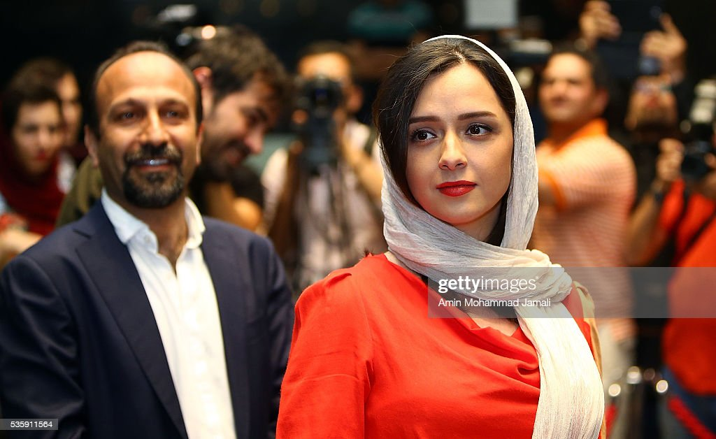 Actress Taraneh Alidousti (R) and Director Asghar Farhad (L) look on during Director <a gi-track='captionPersonalityLinkClicked' href=/galleries/search?phrase=Asghar+Farhadi&family=editorial&specificpeople=5700577 ng-click='$event.stopPropagation()'>Asghar Farhadi</a> and Actor Shahab Hosseini - Press Conference the on May 30, 2016 in Tehran, Iran.