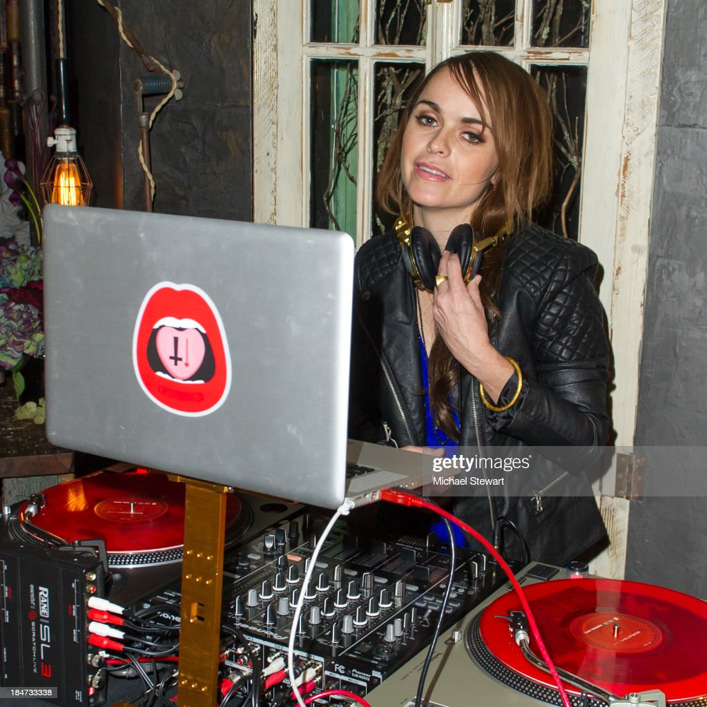 Actress <a gi-track='captionPersonalityLinkClicked' href=/galleries/search?phrase=Taryn+Manning&family=editorial&specificpeople=202146 ng-click='$event.stopPropagation()'>Taryn Manning</a> spins during the Eli Halili Soho Boutique Grand Opening with Vogue Gioiello on October 15, 2013 in New York City.