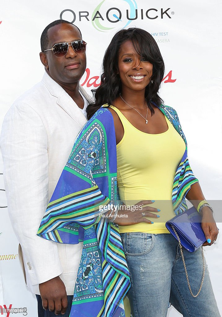 Actress <a gi-track='captionPersonalityLinkClicked' href=/galleries/search?phrase=Tasha+Smith&family=editorial&specificpeople=712139 ng-click='$event.stopPropagation()'>Tasha Smith</a> (R) and her husband Keith Douglas (L) attend the Reed For Hope Foundation's 11th annual 'Sunshine Beyond Summer' celebration on August 31, 2013 in Westlake Village, California.