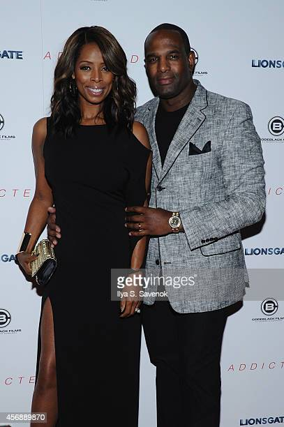 Actress Tasha Smith and Keith Douglas attend the New York Premiere of 'Addicted' at Regal Union Square on October 8 2014 in New York City