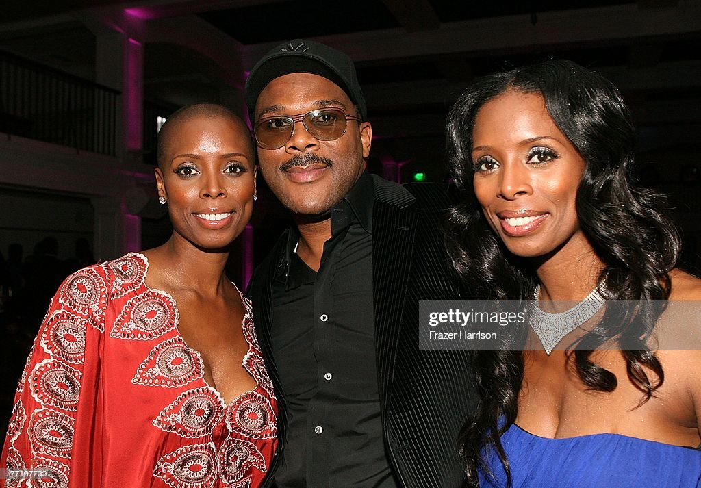 Actress Tasha Smith (right) and twin sister Sidra pose with Tyler Perry at Lionsgate's Premiere Of 'Why Did I Get Married?' held at the The Cinerama Dome, Arclight Hollywood on October 4, 2007 in Los Angeles, California.