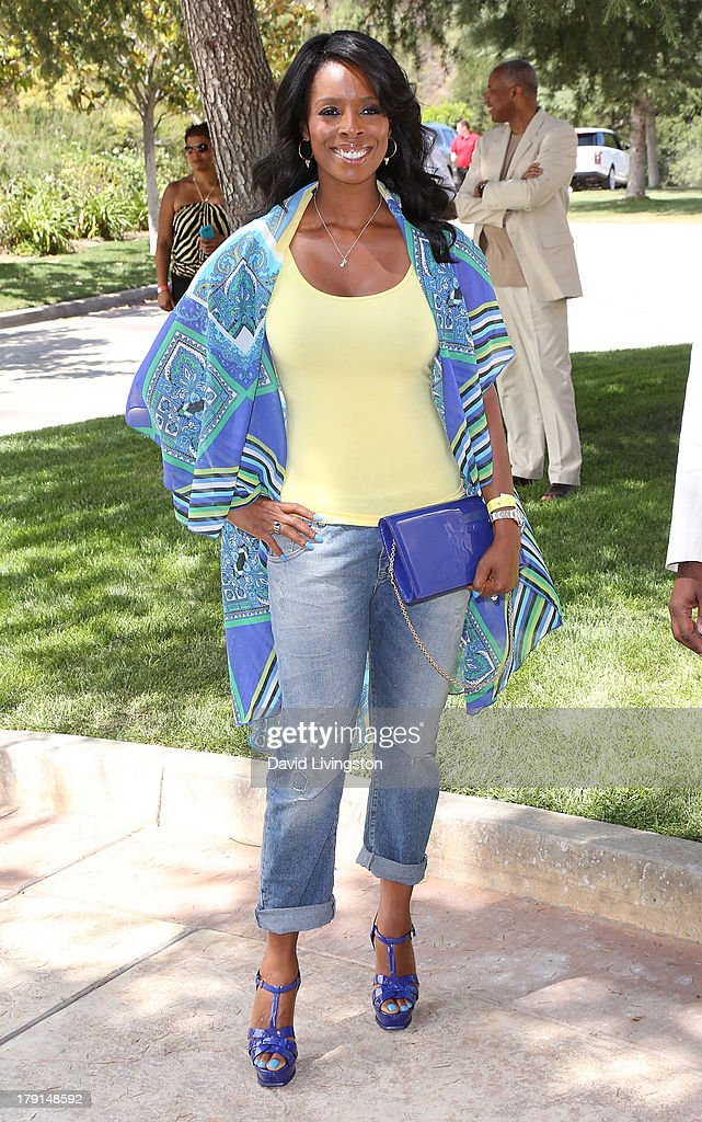 Actress <a gi-track='captionPersonalityLinkClicked' href=/galleries/search?phrase=Tasha+Smith&family=editorial&specificpeople=712139 ng-click='$event.stopPropagation()'>Tasha Smith</a> attends the Reed for Hope Foundation's 11th Annual 'Sunshine Beyond Summer' celebration at a private residence on August 31, 2013 in Westlake Village, California.