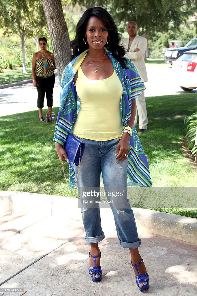 Actress Tasha Smith attends the Reed For Hope Foundation's 11th annual 'Sunshine Beyond Summer' celebration on August 31, 2013 in Westlake Village, California.