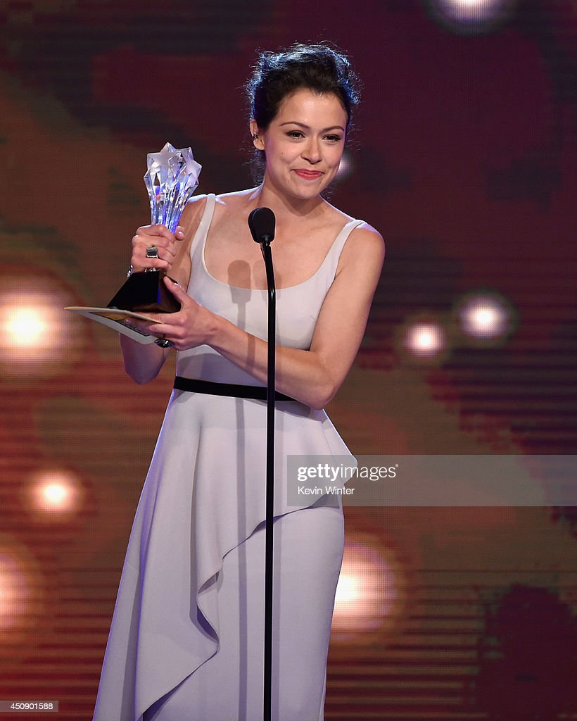 Actress <a gi-track='captionPersonalityLinkClicked' href=/galleries/search?phrase=Tatiana+Maslany&family=editorial&specificpeople=4489724 ng-click='$event.stopPropagation()'>Tatiana Maslany</a> accepts the Best Actress in a Drama Series award for 'Orphan Black' onstage during the 4th Annual Critics' Choice Television Awards at The Beverly Hilton Hotel on June 19, 2014 in Beverly Hills, California.