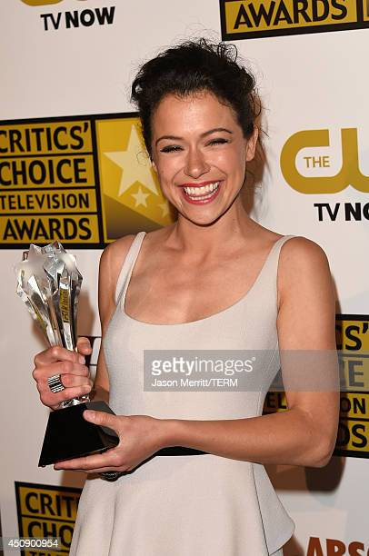 Actress Tatiana Maslany winner of Best Actress in a Drama Series 'Orphan Black' poses in the press room during the 4th Annual Critics' Choice...