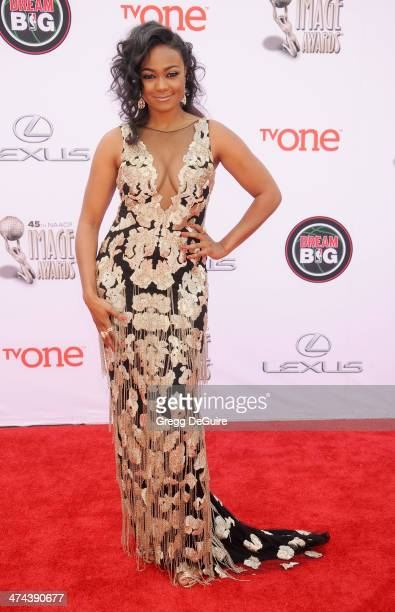 Actress Tatyana Ali arrives at the 45th NAACP Image Awards at Pasadena Civic Auditorium on February 22 2014 in Pasadena California