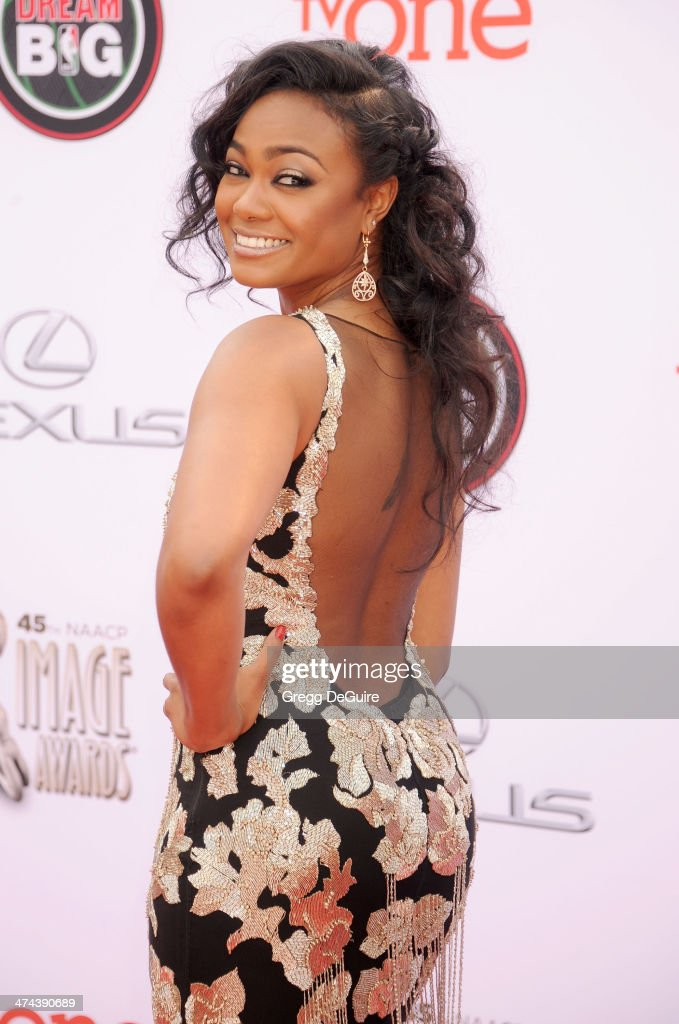 Actress <a gi-track='captionPersonalityLinkClicked' href=/galleries/search?phrase=Tatyana+Ali&family=editorial&specificpeople=847071 ng-click='$event.stopPropagation()'>Tatyana Ali</a> arrives at the 45th NAACP Image Awards at Pasadena Civic Auditorium on February 22, 2014 in Pasadena, California.