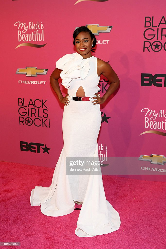 Actress <a gi-track='captionPersonalityLinkClicked' href=/galleries/search?phrase=Tatyana+Ali&family=editorial&specificpeople=847071 ng-click='$event.stopPropagation()'>Tatyana Ali</a> attends BET Black Girls Rock Red Carpet at New Jersey Performing Arts Center on October 26, 2013 in Newark, New Jersey.
