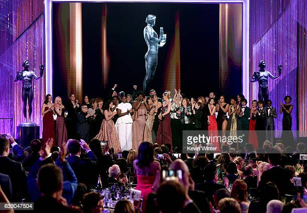 Actress Taylor Schilling and the cast of 'Orange Is the New Black' accept the award for Outstanding Performance by an Ensemble in a Comedy Series...