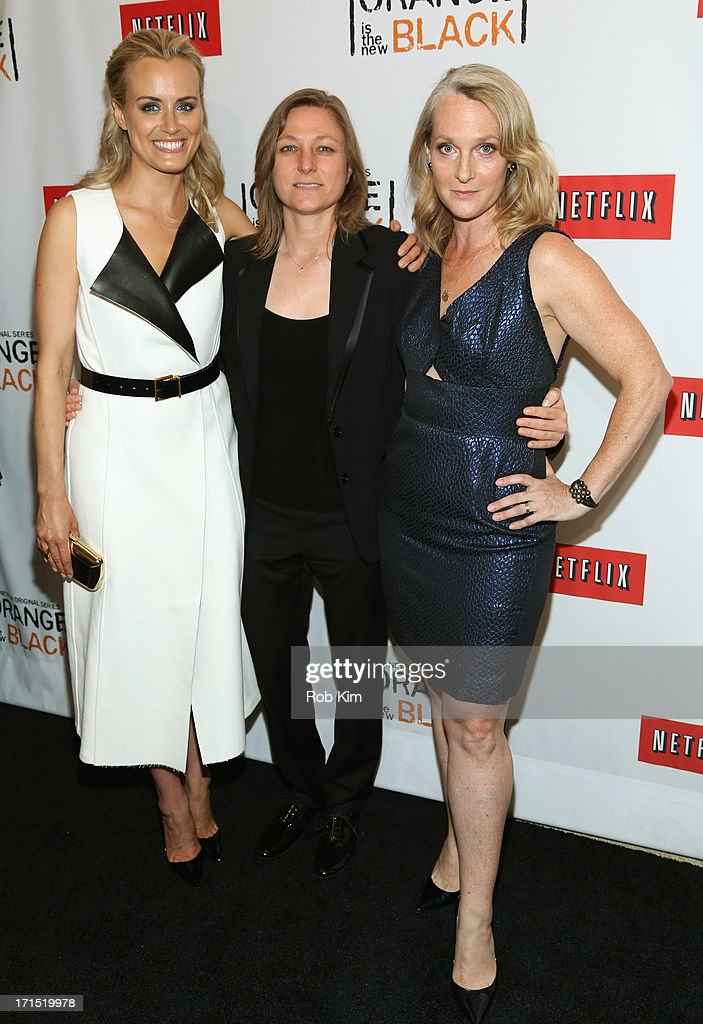 Actress <a gi-track='captionPersonalityLinkClicked' href=/galleries/search?phrase=Taylor+Schilling&family=editorial&specificpeople=5852086 ng-click='$event.stopPropagation()'>Taylor Schilling</a>, Netflix Vice President of Original Content Cindy Holland, and Author Piper Kerman attend 'Orange Is The New Black' New York Premiere at The New York Botanical Garden on June 25, 2013 in New York City.