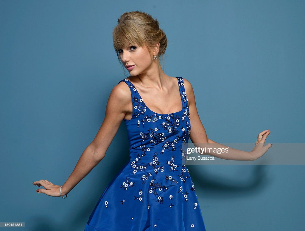 Actress <a gi-track='captionPersonalityLinkClicked' href=/galleries/search?phrase=Taylor+Swift&family=editorial&specificpeople=619504 ng-click='$event.stopPropagation()'>Taylor Swift</a> of 'One Chance' poses at the Guess Portrait Studio during 2013 Toronto International Film Festival on September 9, 2013 in Toronto, Canada.