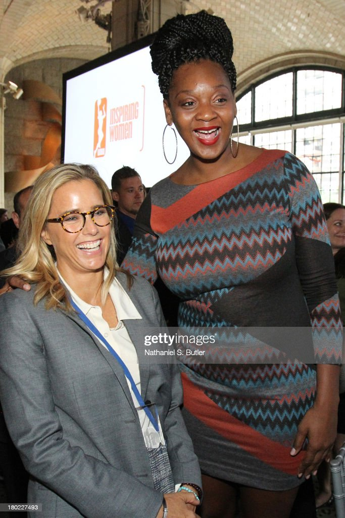 Actress Tea Leoni and Kara Braxton #45 of the New York Liberty pose for a picture at the 2013 WNBA Inspiring Women's Luncheon in New York City.
