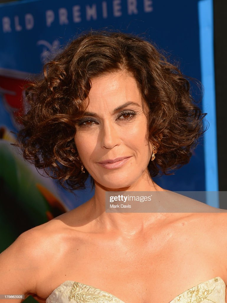 Actress <a gi-track='captionPersonalityLinkClicked' href=/galleries/search?phrase=Teri+Hatcher&family=editorial&specificpeople=202145 ng-click='$event.stopPropagation()'>Teri Hatcher</a> attends the premiere of Disney's 'Planes' at the El Capitan Theatre on August 5, 2013 in Hollywood, California.