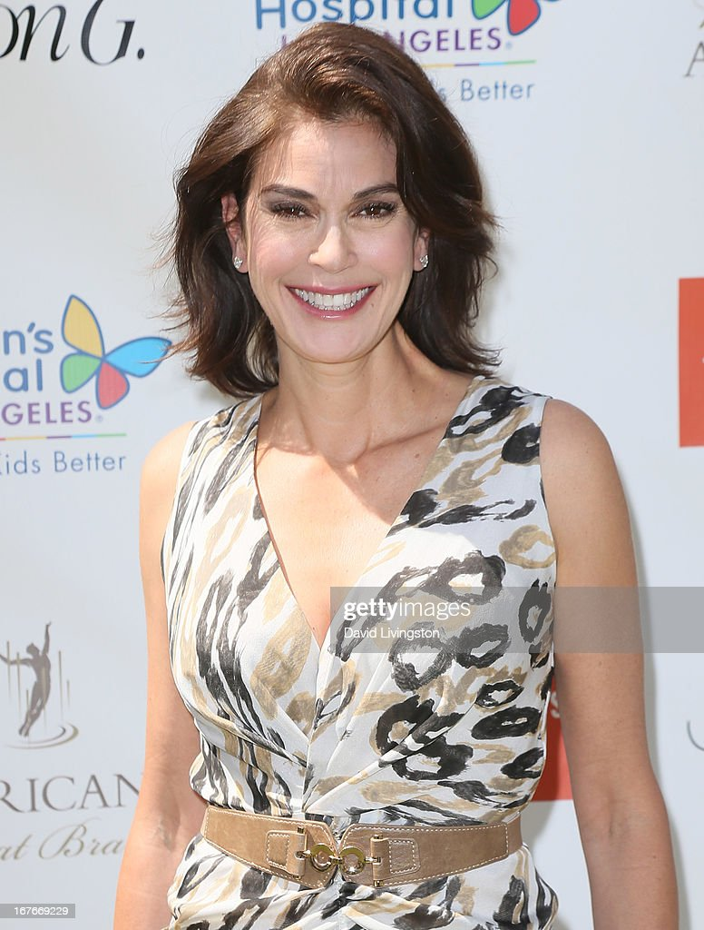 Actress <a gi-track='captionPersonalityLinkClicked' href=/galleries/search?phrase=Teri+Hatcher&family=editorial&specificpeople=202145 ng-click='$event.stopPropagation()'>Teri Hatcher</a> attends the <a gi-track='captionPersonalityLinkClicked' href=/galleries/search?phrase=Teri+Hatcher&family=editorial&specificpeople=202145 ng-click='$event.stopPropagation()'>Teri Hatcher</a> Celebrity Yard Sale and Auction benefiting the Juvenile Arthritis Association at The Americana at Brand on April 27, 2013 in Glendale, California.