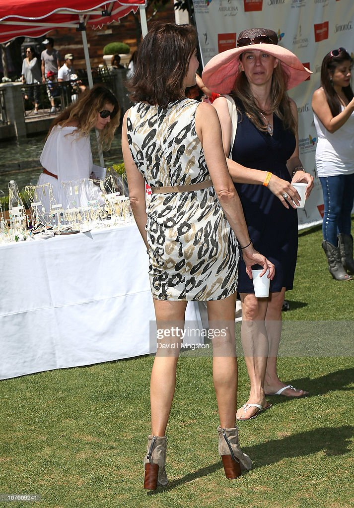 Actress Teri Hatcher (back) attends the Teri Hatcher Celebrity Yard Sale and Auction benefiting the Juvenile Arthritis Association at The Americana at Brand on April 27, 2013 in Glendale, California.