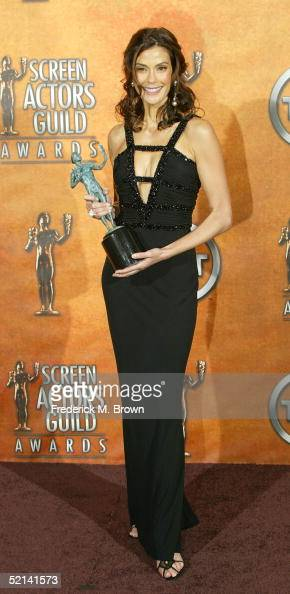 Actress Teri Hatcher poses in the press room with her Actor for Outstanding Performance by a Female Actor in a Comedy Series for 'Desperate...