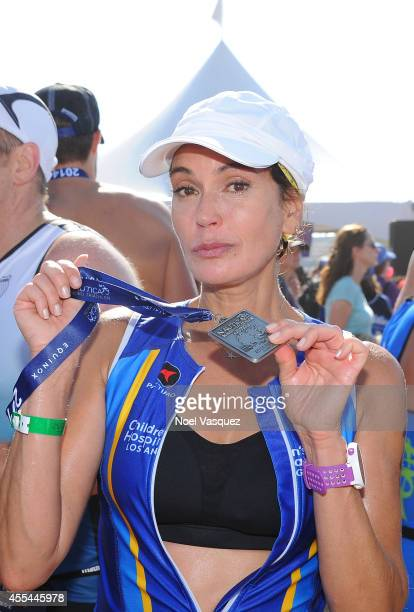 Actress Teri Hatcher shows her medal after finishing the Nautica Malibu Triathlon Presented by Equinox at Zuma Beach on September 14 2014 in Malibu...