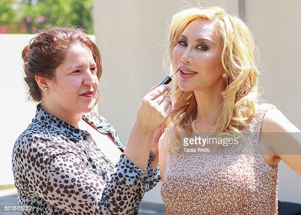 Actress Tess Broussard getting makeup done by makeup artist Jade Martinez at The Starving Artists Project on April 13 2016 in Los Angeles California