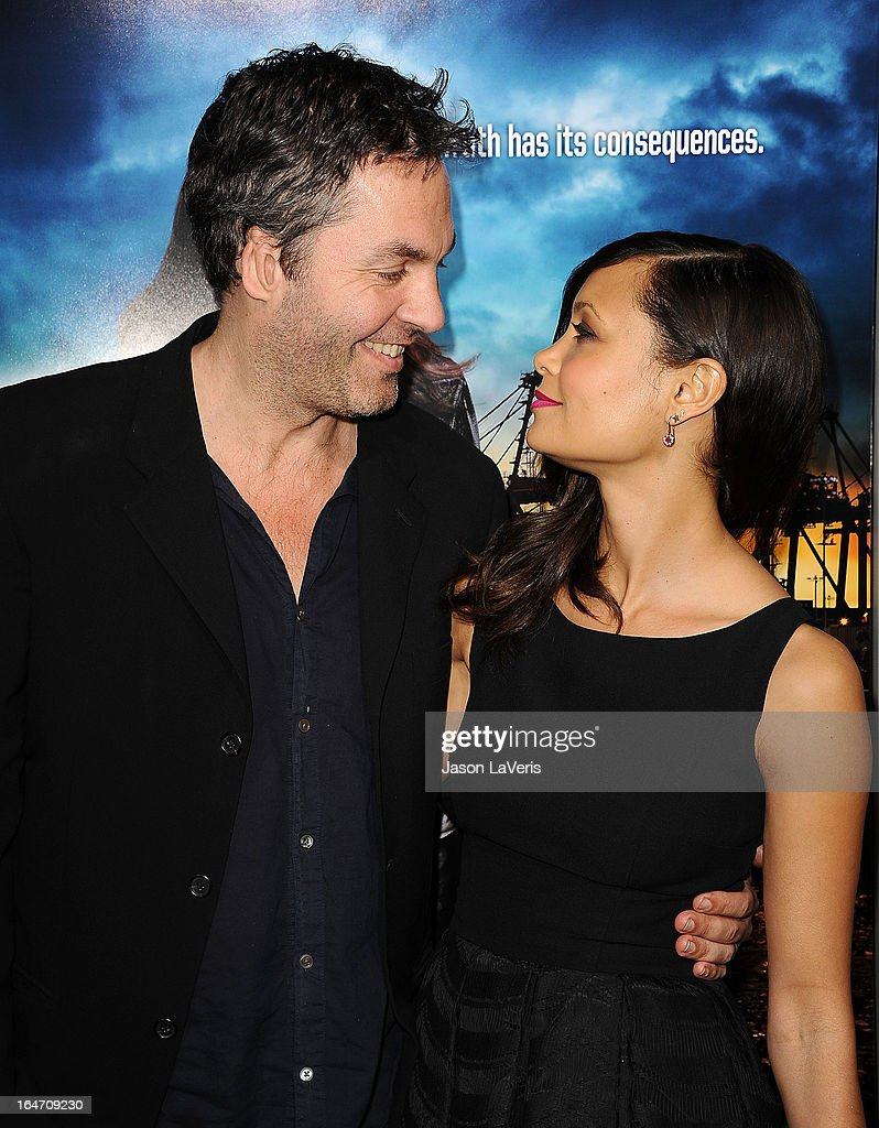 Actress <a gi-track='captionPersonalityLinkClicked' href=/galleries/search?phrase=Thandie+Newton&family=editorial&specificpeople=210812 ng-click='$event.stopPropagation()'>Thandie Newton</a> (R) and husband <a gi-track='captionPersonalityLinkClicked' href=/galleries/search?phrase=Ol+Parker&family=editorial&specificpeople=734633 ng-click='$event.stopPropagation()'>Ol Parker</a> attend the premiere of 'Rogue' at ArcLight Hollywood on March 26, 2013 in Hollywood, California.