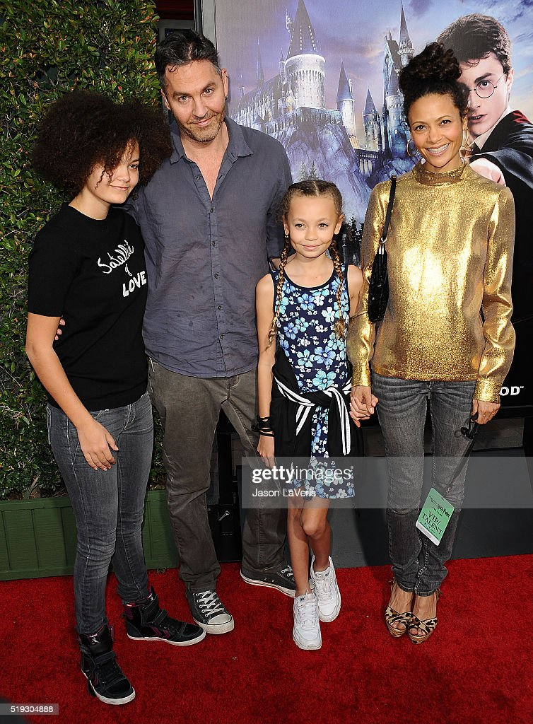 Actress <a gi-track='captionPersonalityLinkClicked' href=/galleries/search?phrase=Thandie+Newton&family=editorial&specificpeople=210812 ng-click='$event.stopPropagation()'>Thandie Newton</a>, husband <a gi-track='captionPersonalityLinkClicked' href=/galleries/search?phrase=Ol+Parker&family=editorial&specificpeople=734633 ng-click='$event.stopPropagation()'>Ol Parker</a> and children Ripley Parker and Nico Parker attend the opening of 'The Wizarding World of Harry Potter' at Universal Studios Hollywood on April 5, 2016 in Universal City, California.
