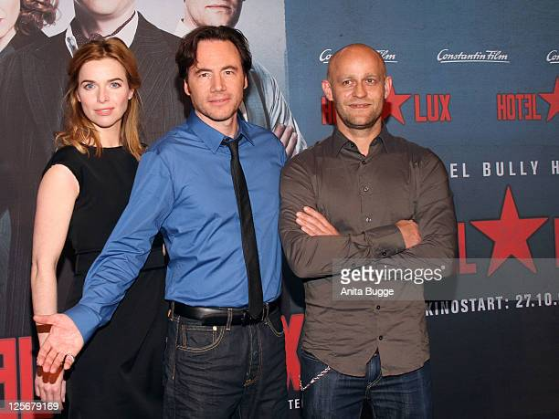 Actress Thekla Reuten actor Michael 'Bully' Herbig and actor Juergen Vogel attend the screening of 'Hotel Lux' at the Cinestar movie theater on...