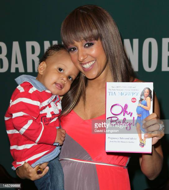 Actress Tia Mowry and son Cree Hardrict attend a signing for her book 'Oh Baby Pregnancy Tales and Advice from One Hot Mama to Another' at Barnes...