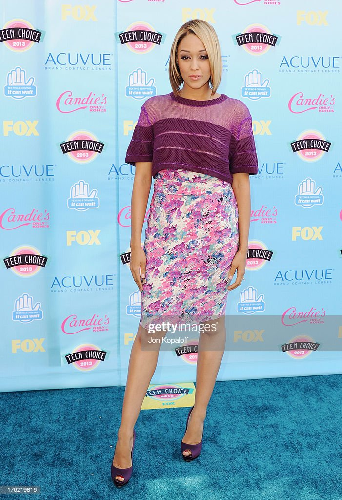 Actress Tia Mowry arrives at the 2013 Teen Choice Awards at Gibson Amphitheatre on August 11, 2013 in Universal City, California.
