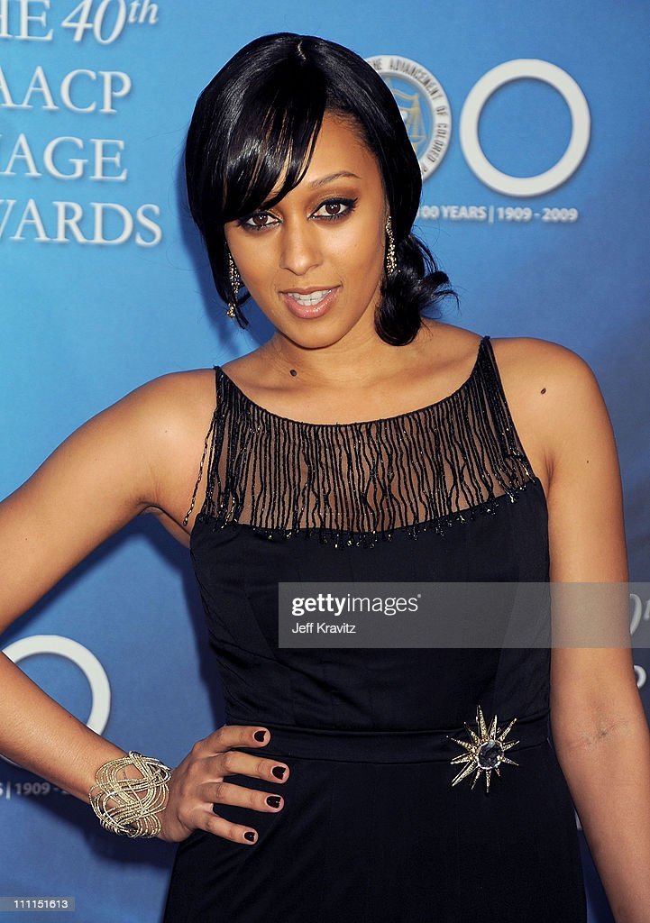Actress <a gi-track='captionPersonalityLinkClicked' href=/galleries/search?phrase=Tia+Mowry&family=editorial&specificpeople=631098 ng-click='$event.stopPropagation()'>Tia Mowry</a> arrives at the 40th NAACP Image Awards held at the Shrine Auditorium on February 12, 2009 in Los Angeles, California.