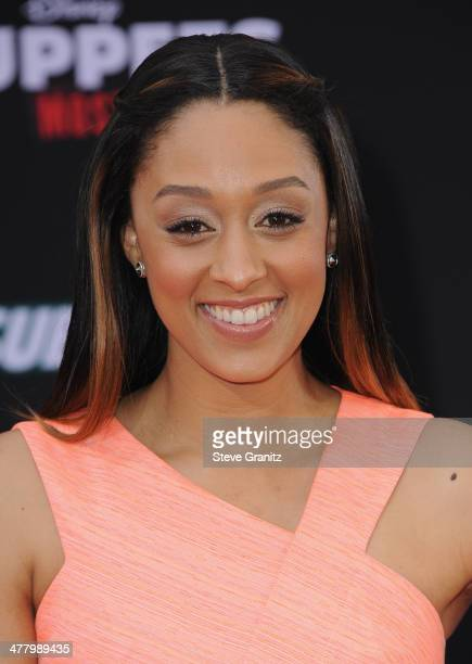 Actress Tia Mowry arrives for Disney's 'Muppets Most Wanted' Los Angeles Premiere at the El Capitan Theatre on March 11 2014 in Hollywood California