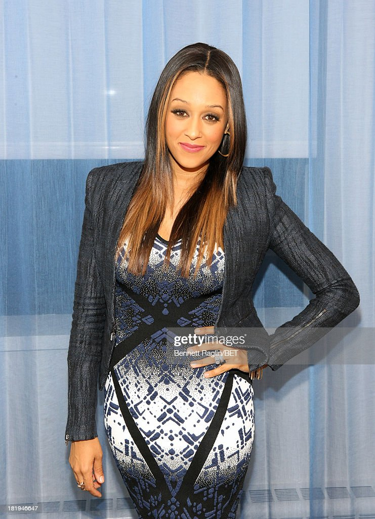 Actress <a gi-track='captionPersonalityLinkClicked' href=/galleries/search?phrase=Tia+Mowry&family=editorial&specificpeople=631098 ng-click='$event.stopPropagation()'>Tia Mowry</a> visits 106 & Park at 106 & Park on September 23, 2013 in New York City.