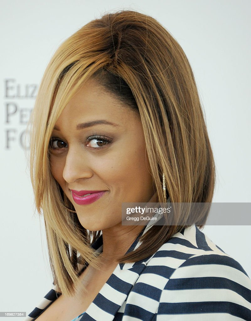 Actress <a gi-track='captionPersonalityLinkClicked' href=/galleries/search?phrase=Tia+Mowry&family=editorial&specificpeople=631098 ng-click='$event.stopPropagation()'>Tia Mowry</a>-Hardrict arrives at the Elizabeth Glaser Pediatric AIDS Foundation's 24th Annual 'A Time For Heroes' at Century Park on June 2, 2013 in Los Angeles, California.