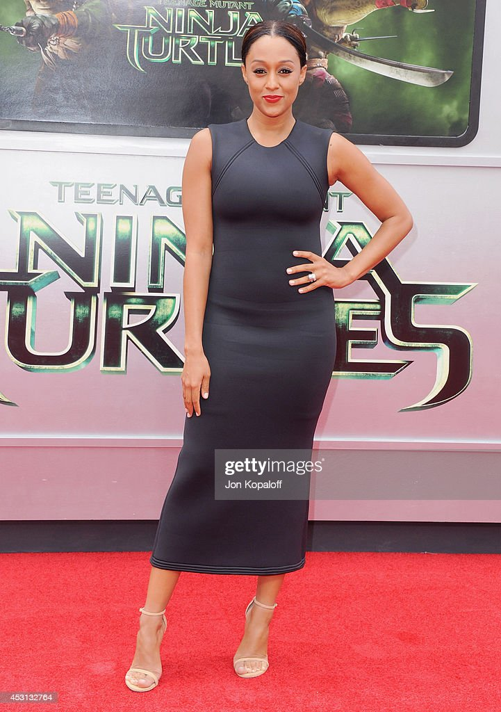 Actress <a gi-track='captionPersonalityLinkClicked' href=/galleries/search?phrase=Tia+Mowry&family=editorial&specificpeople=631098 ng-click='$event.stopPropagation()'>Tia Mowry</a>-Hardrict arrives at the Los Angeles Premiere 'Teenage Mutant Ninja Turtles' at Regency Village Theatre on August 3, 2014 in Westwood, California.