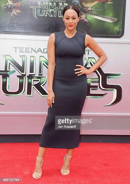 Actress Tia MowryHardrict arrives at the Los Angeles Premiere 'Teenage Mutant Ninja Turtles' at Regency Village Theatre on August 3 2014 in Westwood...