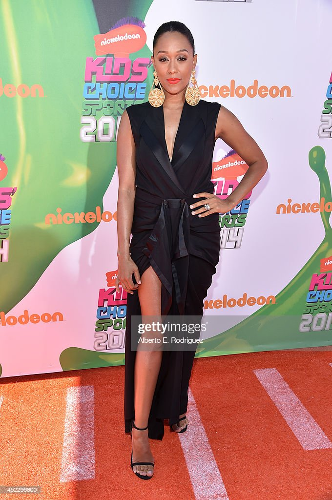 Actress <a gi-track='captionPersonalityLinkClicked' href=/galleries/search?phrase=Tia+Mowry&family=editorial&specificpeople=631098 ng-click='$event.stopPropagation()'>Tia Mowry</a>-Hardrict attends Nickelodeon Kids' Choice Sports Awards 2014 at UCLA's Pauley Pavilion on July 17, 2014 in Los Angeles, California.