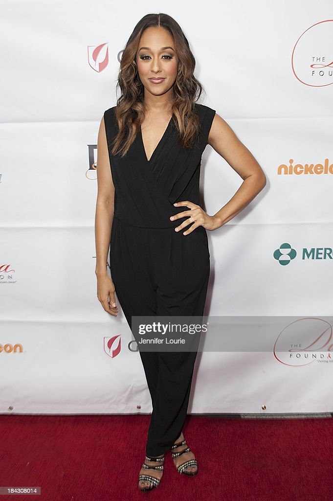 Actress <a gi-track='captionPersonalityLinkClicked' href=/galleries/search?phrase=Tia+Mowry&family=editorial&specificpeople=631098 ng-click='$event.stopPropagation()'>Tia Mowry</a>-Hardrict attends the 23rd Annual HIV/AIDS benefit concert DIVAS Simply Singing! at Club Nokia on October 12, 2013 in Los Angeles, California.
