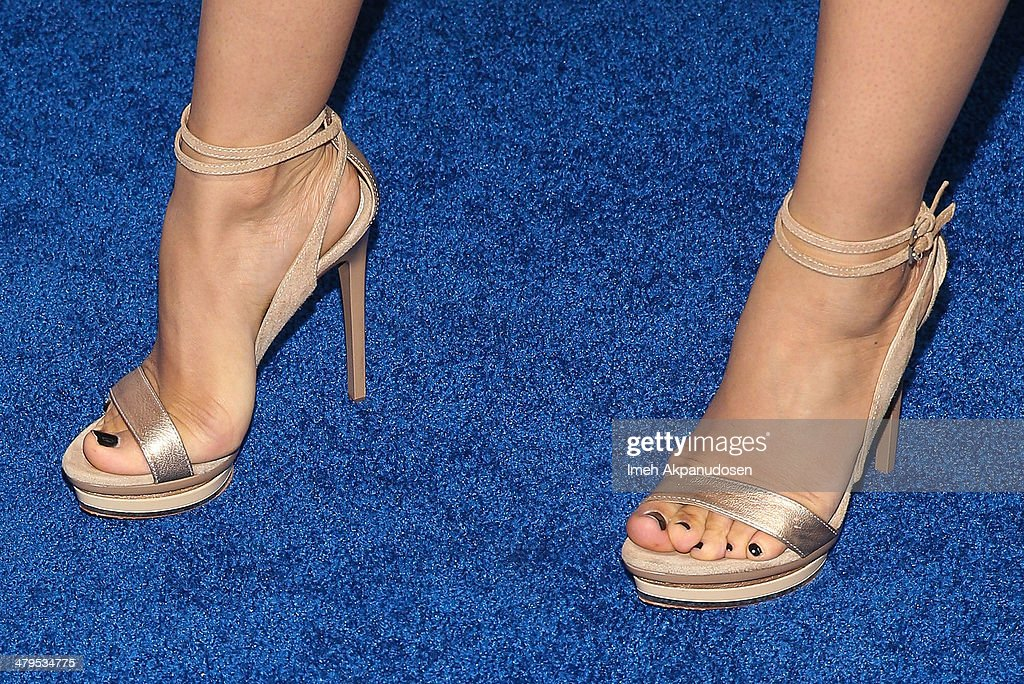 Actress <a gi-track='captionPersonalityLinkClicked' href=/galleries/search?phrase=Tia+Mowry&family=editorial&specificpeople=631098 ng-click='$event.stopPropagation()'>Tia Mowry</a>-Hardrict (shoe detail) attends the 2nd Annual Norma Jean Gala at The Paley Center for Media on March 18, 2014 in Beverly Hills, California.