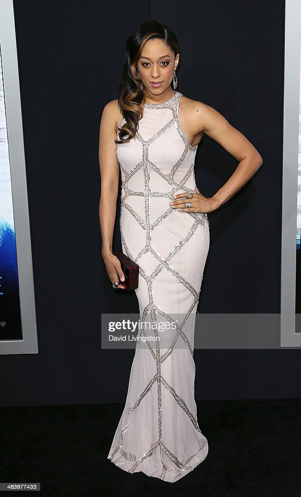Actress <a gi-track='captionPersonalityLinkClicked' href=/galleries/search?phrase=Tia+Mowry&family=editorial&specificpeople=631098 ng-click='$event.stopPropagation()'>Tia Mowry</a>-Hardrict attends the premiere of Warner Bros. Pictures and Alcon Entertainment's 'Transcendence' at the Regency Village Theatre on April 10, 2014 in Westwood, California.