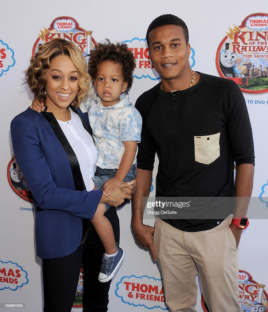 Actress Tia Mowry-Hardrict, son Cree Hardrict and husband Cory Hardrict arrive at the Los Angeles premiere of 'Thomas & Friends: King Of The Railway - The Movie' at Pacific Theatre at The Grove on September 15, 2013 in Los Angeles, California.