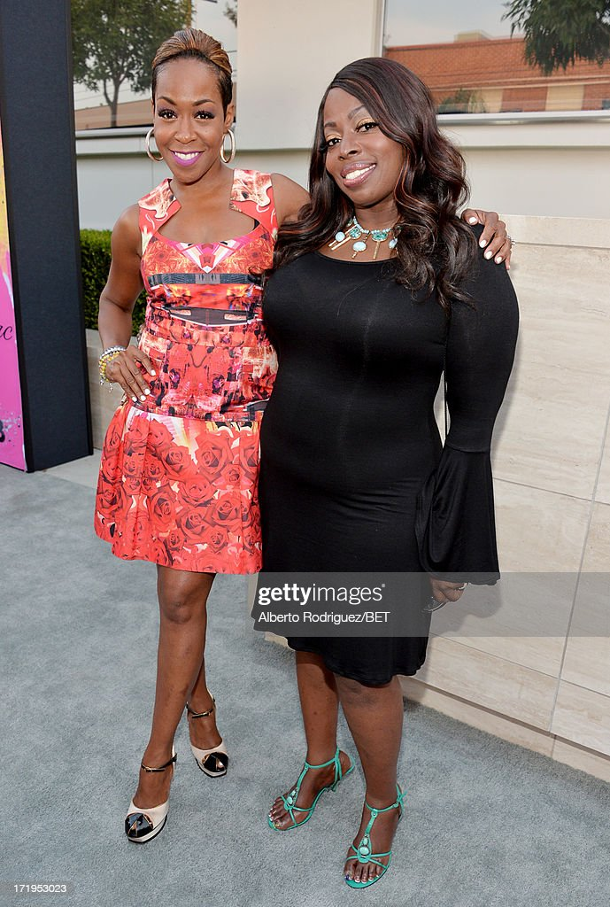 Actress Tichina Arnold (L) and singer Angie Stone attend Debra Lee's Pre-BET Awards Celebration Dinner at Milk Studios on June 29, 2013 in Los Angeles, California.