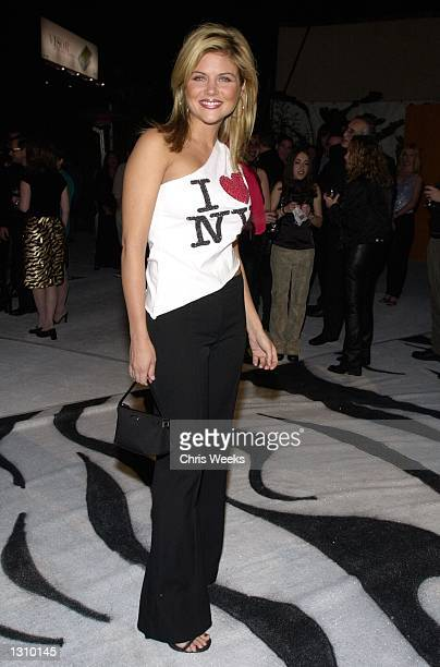Actress Tiffani Amber Theissen arrives at a party thrown by Motorola December 7 2000 in Hollywood CA