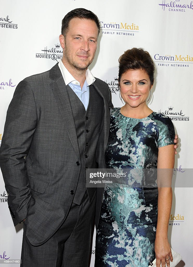 Actress Tiffani Thiessen and Brady Smith arrive at Hallmark Channel's annual holiday event premiere screening of 'Northpole' at La Piazza Restaurant...