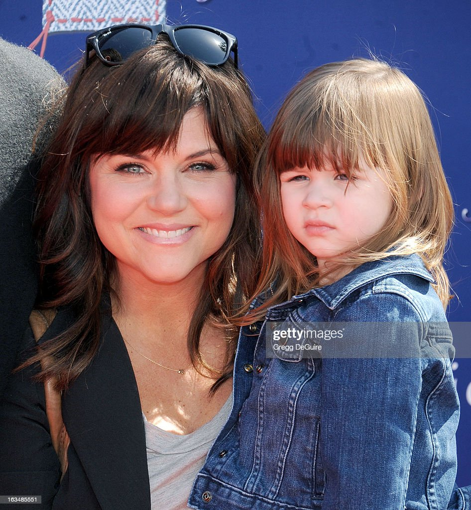 Actress <a gi-track='captionPersonalityLinkClicked' href=/galleries/search?phrase=Tiffani+Thiessen&family=editorial&specificpeople=221649 ng-click='$event.stopPropagation()'>Tiffani Thiessen</a> and daughter Harper arrive at John Varvatos 10th Annual Stuart House Benefit at John Varvatos Los Angeles on March 10, 2013 in Los Angeles, California.