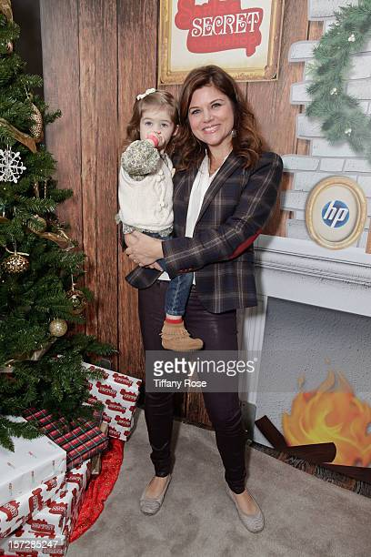 Actress Tiffani Thiessen and daughter Harper Smith attend the 2nd Annual Santa's Secret Workshop Benefiting LA Family Housing at Andaz on December 1...