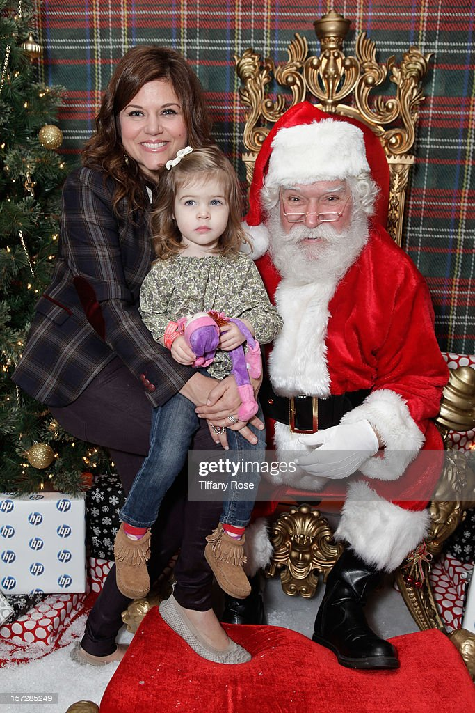 Actress <a gi-track='captionPersonalityLinkClicked' href=/galleries/search?phrase=Tiffani+Thiessen&family=editorial&specificpeople=221649 ng-click='$event.stopPropagation()'>Tiffani Thiessen</a> and daughter Harper Smith attend the 2nd Annual Santa's Secret Workshop Benefiting L.A. Family Housing at Andaz on December 1, 2012 in West Hollywood, California.